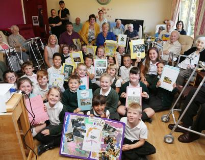 Schoolchildren visit care home residents...