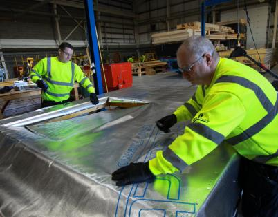 Offsite manufacturing: installing windows in closed timber panels